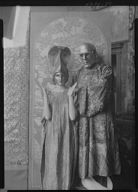 People wearing masks made by W.T. Benda