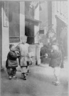 Three children standing on a sidewalk, Chinatown, San Francisco