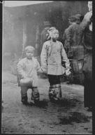 Two children walking down a street, Chinatown, San Francisco