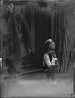 Small boy standing in front of a doorway, Chinatown, San Francisco