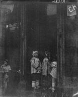 Three girls standing in a doorway, Chinatown, San Francisco
