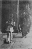 Young girl walking down a street, Chinatown, San Francisco