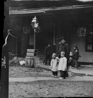 Man and two children crossing a street, Chinatown, San Francisco