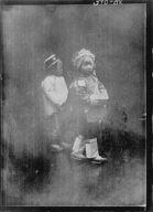 Two children walking down the street, Chinatown, San Francisco