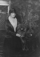 Witthaus, G.H., Mrs., with dogs, portrait photograph