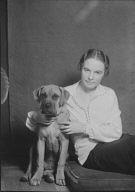 Hocke, Edith, with dog, portrait photograph