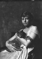Cluett, Marjorie, Miss, with Buzzer the cat, portrait photograph