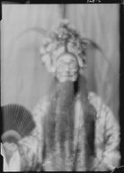 "Actor in costume as Wu Sin Yin for the play ""Yellow jacket"""