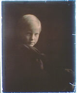 Boy with blonde hair dressed in black