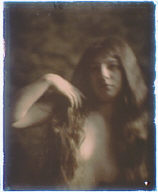 Nude woman with long brown hair
