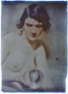 Nude study of a woman holding a glass ball