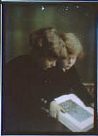 Children of Willam Astor Chanler looking at a book