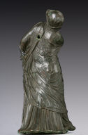 Statuette of a veiled and masked dancer