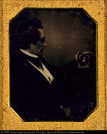 Young Man Looking at a Daguerreotype