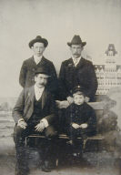 Studio Portrait in front of the Cliff House [three men in hats and young boy]