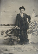 Studio Portrait in front of Cliff House [man in hat leaning on stump]