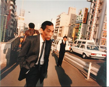 A Businessman, Outside Shinjuku Station, Tokyo, from the portfolio Map of the East