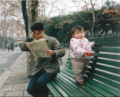 A Baby in a Padded Coat, In the French Park, Shanghai, from the portfolio Map of the East