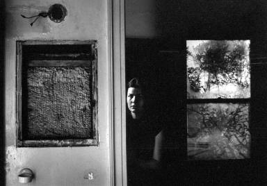 Woman Seated by Doorway