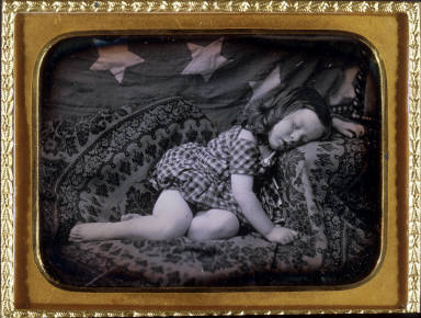 Albert Pritchard Root asleep with American flag draped in background