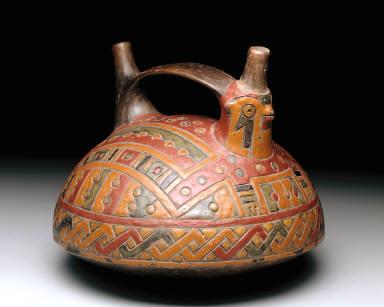 Double-spout strap-handle vessel depicting a falcon