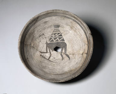Bowl with Man Carrying a Basket