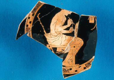 Kylix (wine cup) with man decorating a kylix
