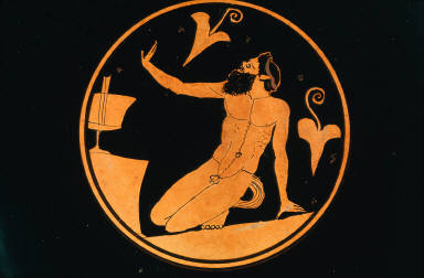 Kylix (wine cup) with kneeling silen