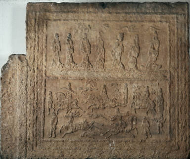 Wall panel of a tomb with carved scenes of a deer hunt and seven figures