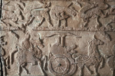 Wall panel of a tomb with carved beasts and chariots