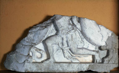 Relief fragment from part of a rail coping: Garland Bearer
