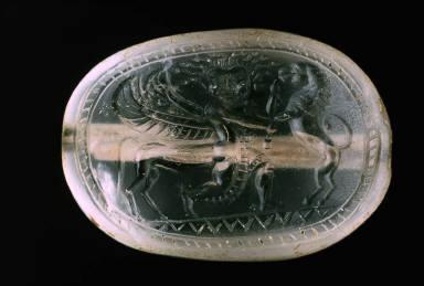 Scaraboidal intaglio with Medusa as winged centaur seizing a lion
