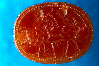 Scarab with dead youth and 2 winged figures