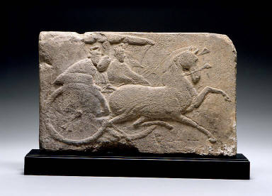Tile with horse-drawn chariot