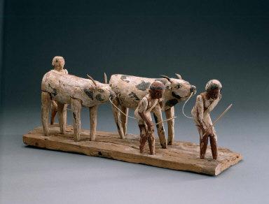 Model of men herding cattle