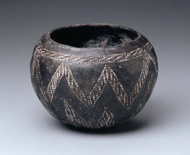 Black-polished bowl with white-filled, incised decoration