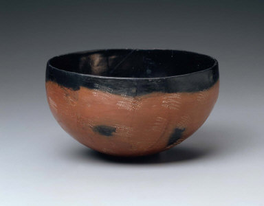 Black-topped, red-polished bowl with elaborate impressed decoration