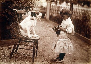 Child Photographing Dog