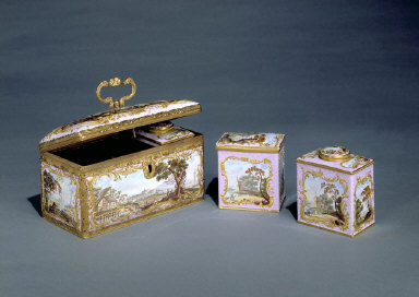 CASKET containing two tea canisters and a sugar box