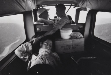Untitled [three people in airplane]