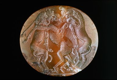 Lentoid seal with 2 lions biting a stag