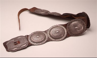 Concho belt seven conchos and buckle on leather strap