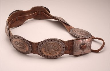 Concha belt seven oval conchas, one rectangular buckle