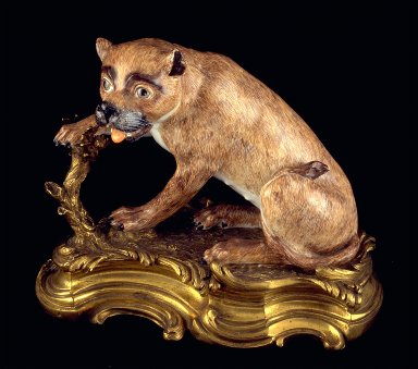 Statue of a seated lioness Dresden china with ormolu mounts