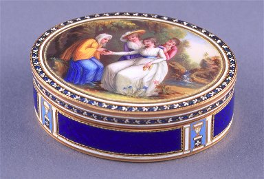 Oval snuff box of royal blue enamel with fortune telling scene on the lid