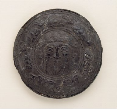 """Roundel with the head of a """"hero"""" surrounded by caprids"""
