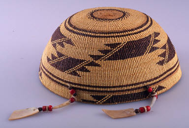 Basketry cap three hanging strands w. red beads, disk shells, abalone shells & brown seedsa