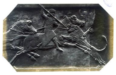 Asshurbanipal on Horseback Spearing a Lion, an Assyrian marble slab from Kouyunjik now in the British Museum
