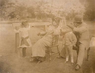 Lilian Hervey, Kathleen Newton, Cecil George Newton and Tissot (?) in the Garden