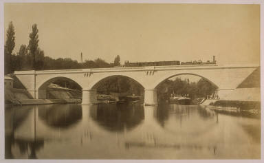 Untitled (bridge with train over canal)